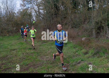 Anguillara Sabazia (Rome), Italy - December 09, 2018: Athletes compete in the 'Trail dei due laghi' foot race in a 20 km course and a drop of 480 mete - Stock Photo
