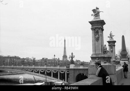 Pont Alexandre III (Alexander III Bridge), the Seine and the Eiffel Tower in the distance, Paris, France.  Black and white version - Stock Photo