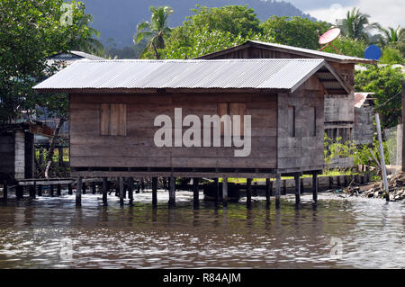 A Wooden House on stilts in the water in Panama - Stock Photo