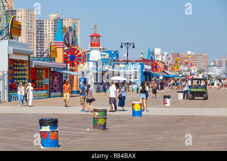 New York, USA - July 02, 2018: Coney Island famous boardwalk on a sunny day.