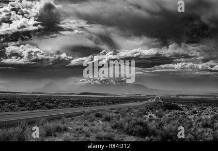 Black and White of a Utah highway on a stormy day. - Stock Photo