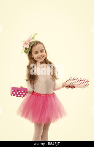 Childhood and happiness. Holiday celebration and mothers day. Christmas and birthday. Child or happy kid with present pack isolated on white background. Small girl with gift box with red bow - Stock Photo