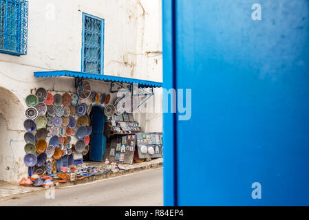 Souvenirs for sale in the historic blue and white town of Sidi Bou Said, Tunisia - Stock Photo