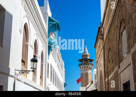 View of the medina in Tunis, Tunisia with the minaret of Hammouda Pacha Mosque and blue sky - Stock Photo