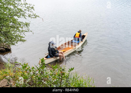 Lake Easton State Park, Washington, USA.  Grandfather and his 10 year old grandson out on Lake Easton in a canoe. - Stock Photo