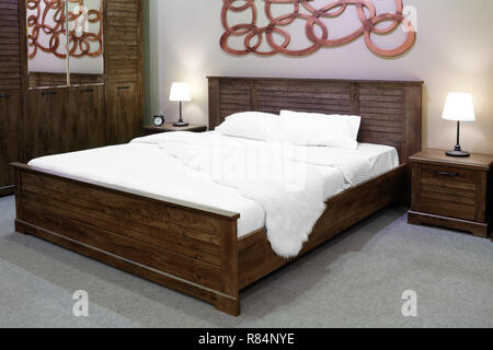 luxury modern and wooden rustic style bedroom in brown and beige tones, Interior of a hotel bedroom - Stock Photo