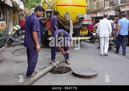 Municipal workers in Mumbai, India, cleaning the drainage system - Stock Photo