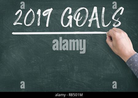 New year 2019 resolutions goal on blackboard - Stock Photo
