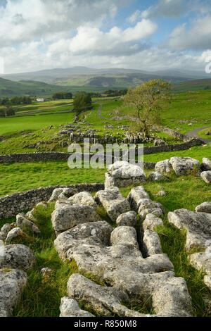 Scenic view across limestone pavement & rolling upland countryside from Winskill Stones, above Langcliffe & Stainforth, Yorkshire Dales, England, UK. - Stock Photo