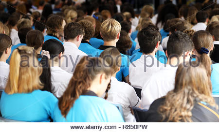 wide shot of a large number of high school students in colored coloured mixed uniforms facing the front at assembly listening attentively to awards, p - Stock Photo