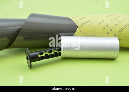 old vintage camera roll film on a green background,image of a - Stock Photo
