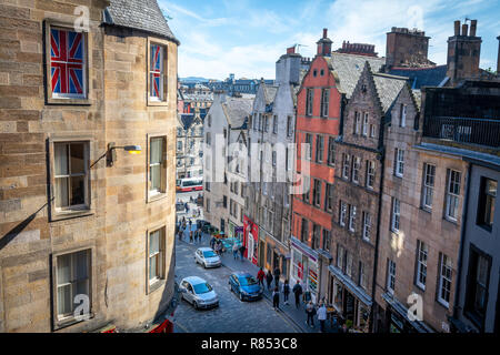 A Union Jack flag rests proudly in a window overlooking a busy street, Edinburgh, Scotland, UK. - Stock Photo