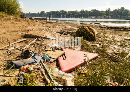Polluted river bank by some random trash making huge ecological problem in Serbia - Stock Photo