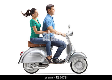 Full length profile shot of a young couple riding on a vintage motorbike isolated on white background - Stock Photo
