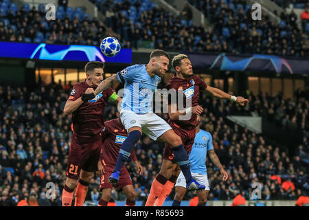 12th December 2018, Etihad Stadium, Manchester, England; UEFA Champions League, Manchester City v TSG 1899 Hoffenheim ; Nicolas Otamendi (30) of Manchester City heads on goal from Phil Foden (47) of Manchester City's free-kick and it just goes over the bar   Credit: Mark Cosgrove/News Images - Stock Photo