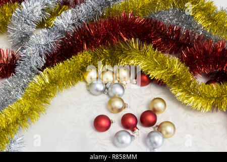 Gold silver and red Christmas balls and tinsel - Stock Photo