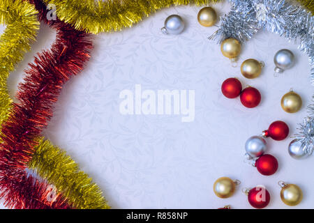 Christmas decoration with bauble and tinsel with copy space - Stock Photo