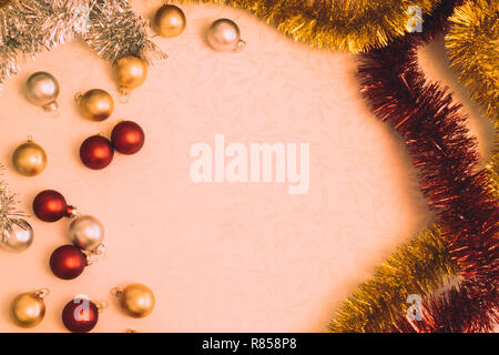 Vintage picture of Christmas balls and tinsel with copy space - Stock Photo