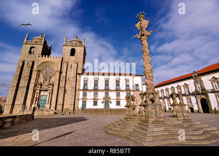 Impressing granite cathedral and medieval pillory at town square of Porto - Stock Photo