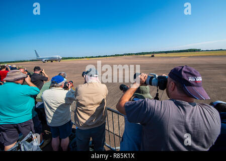 Photographers in the crowd at the Royal International Air Tattoo, RIAT, RAF Fairford airshow focus in on a US Navy Boeing P-8 Poseidon taxiing in - Stock Photo