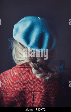 Historical woman in winter coat holding a book