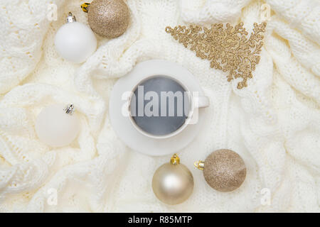 Top view winter christmas warm cozy mock up. Flat lay on white background - cup of coffee, knitted plaid, sweater mockup. Christmas decoration composition, greetings card, postcard mock-up - Stock Photo