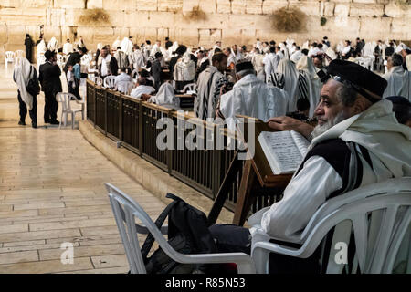 Religious orthodox jew praying at the Western wall and reads the Torah in Jerusalem old city. JERUSALEM, ISRAEL. 24 October 2018. - Stock Photo