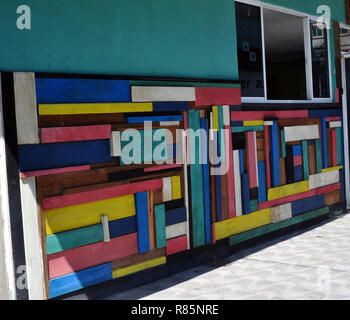 A Colorful Wall made with different colored boards that go in different directions - Stock Photo