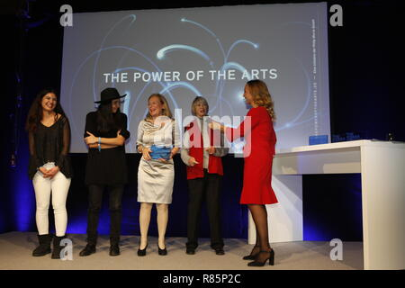 Berlin, Germany. 12th Dec 2018. Jury Member Diana Kinnert (second from the left) and the winners KulturistenHoch2 (Hamburg).  On the 12th of December the solemn award ceremony of the initiative 'The Power of the Arts' takes place for the second time in Berlin. With 200,000 euros it is the highest endowed prize for cultural participation in Germany. Credit: SAO Struck/Alamy Live News - Stock Photo