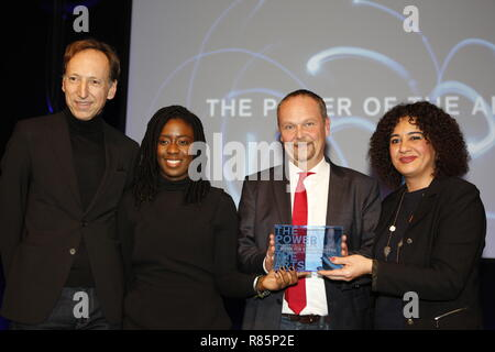 Berlin, Germany. 12th Dec 2018. Jury Member Hans-Jörg Clement (left) and the winners the Stadtteilkantorat Mümmelmannsberg (Hamburg).  On the 12th of December the solemn award ceremony of the initiative 'The Power of the Arts' takes place for the second time in Berlin. With 200,000 euros it is the highest endowed prize for cultural participation in Germany. Credit: SAO Struck/Alamy Live News - Stock Photo