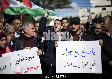 Gaza City, The Gaza Strip, Palestine. 13th Dec, 2018. Protesters are seen holding placards and flags while chanting slogans during the protest.Supporters of the Palestinian factions participated in a protest, following the execution by the Israeli army of the three Palestinians in the West Bank. Credit: Mahmoud Issa/SOPA Images/ZUMA Wire/Alamy Live News - Stock Photo