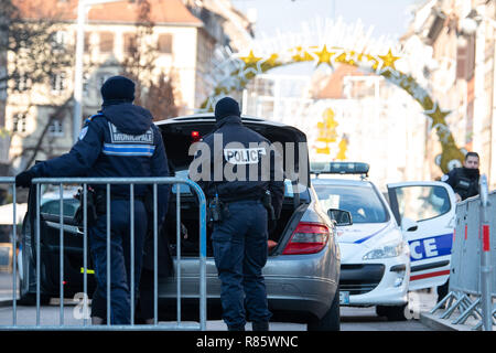 Strasbourg, France. 13th Dec 2018. Cops are checking a car at the downtown entrance. After the serious terrorist attack in Strasbourg, police in France and Germany are hunting down the assassin. Credit: Sebastian Gollnow/dpa/Alamy Live News Stock Photo