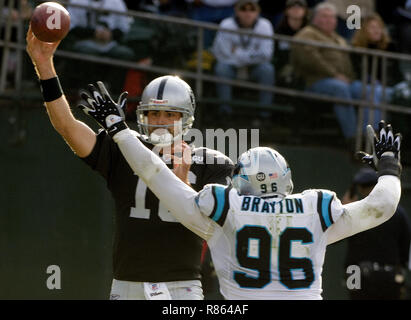Oakland, California, USA. 9th Nov, 2008. Under pressure all day, Oakland Raiders quarterback Andrew Walter #16 passes ball over head of Carolina Panthers defensive end Tyler Brayton #96 on Sunday, November 9, 2008, at Oakland-Alameda County Coliseum in Oakland, California. The Panthers defeated the Raiders 17-6. Credit: Al Golub/ZUMA Wire/Alamy Live News - Stock Photo
