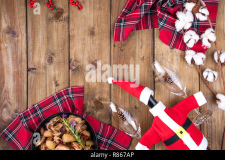 Holiday serving and fried potatoes with mushrooms and meat on a wooden table. Delicious traditional winter food in Russia. Celebration of Christmas an - Stock Photo