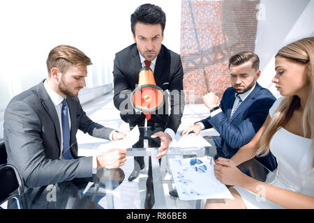 angry Manager with a megaphone at the meeting - Stock Photo