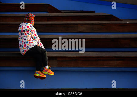 BUCHAREST, ROMANIA - DECEMBER 8, 2018. Girl on stairs in Drumul Taberei Park, also known as Moghioros, in Bucharest, Romania - Stock Photo