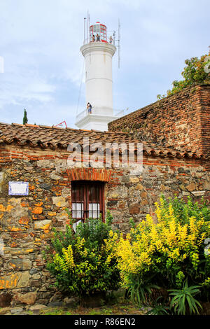 Stone houses and lighthouse in Colonia del Sacramento, Uruguay. It is one of the oldest towns in Uruguay - Stock Photo