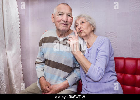 Happy affectionate mature old man and woman embracing