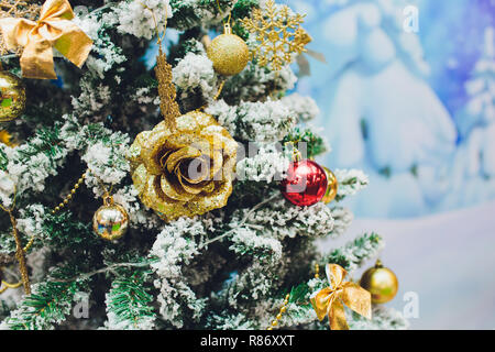 Christmas tree background and Christmas decorations with snow, blurred, sparking, glowing. Happy New Year and Xmas theme. - Stock Photo