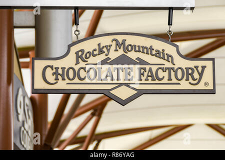 SEATTLE, WA, USA - JUNE 2018: Close up view of a sign outside the Rocky Mountain Chocolate Factory store at the Premium Outlets shopping mall in Tulal - Stock Photo