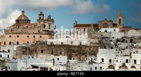 The 'White City' of Ostuni in Puglia, southern Italy is built on top of a hill and crowned by its Gothic  Cathedral and Bishop's Palace. - Stock Photo