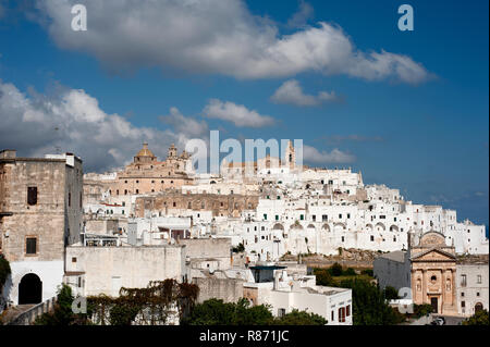 The picturesque old town of Ostuni in southern Italy, built on top of a hill and crowned by its Gothic Basilica or Cathedral. - Stock Photo