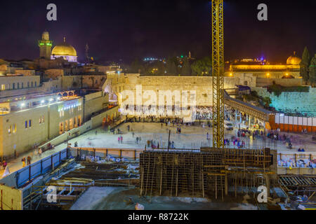 Jerusalem, Israel - December 09, 2018: The Western Wall crowded with Hanukkah Holiday prayers, and Al-Aqsa mosque in the background. Jerusalem, Israel - Stock Photo
