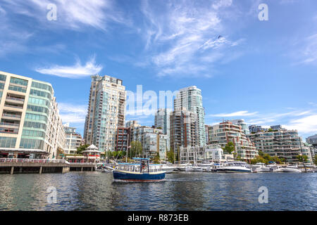 Vancouver, Canada - Set 20th 2017 - Plenty of boats in front of buildings in Vancouver during a blue sky day in Canada - Stock Photo