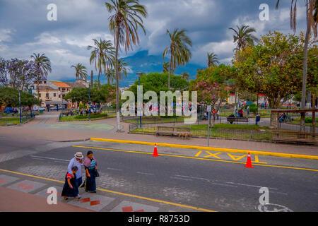 COTACACHI, ECUADOR, NOVEMBER 06, 2018: People in Calderon Park, Cotacachi, Ecuador, in front of Matriz Church - Stock Photo