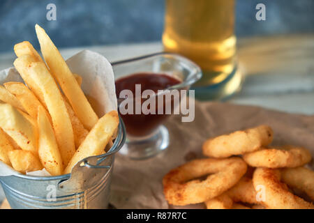 a variety of snacks for light beer in a glass - Stock Photo