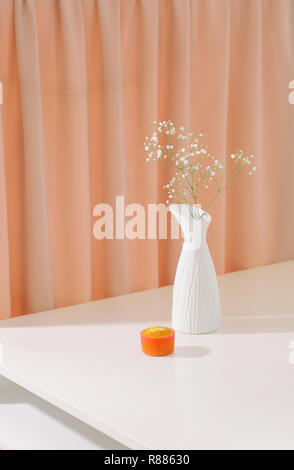 Gypsophila (Baby's breath flowers), in bottle on textured background. Beautiful light, airy masses of small white flowers. floral still life as Interi - Stock Photo