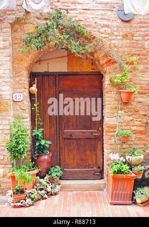 Door to home in Casole d'Elsa, Tuscany, Italy - Stock Photo