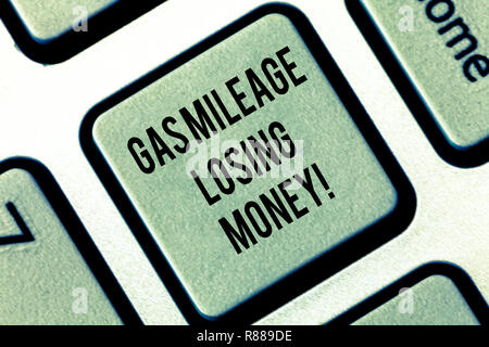 Writing note showing Gas Mileage Losing Money. Business photo showcasing Long road high gas fuel costs financial losses Keyboard key Intention to crea - Stock Photo