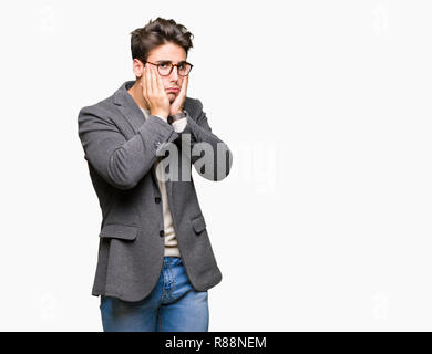 Young business man wearing glasses over isolated background Tired hands covering face, depression and sadness, upset and irritated for problem - Stock Photo